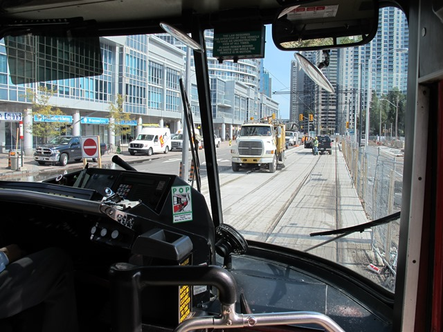 Oct 07, 2014/Toronto, ON:   TTC. EB #4164. Queens Quay at Simcoe St. First car to Union, testing track & overhead structure.